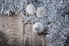 White christmas balls on a wooden background.  Royalty Free Stock Photo