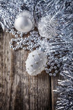 White christmas balls on a wooden background.  Stock Photos
