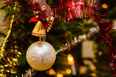 White Christmas Baube. A small ornamen hanging in the Christmas tree. In Finland, the christmas trees are typically real pine trees royalty free stock photography