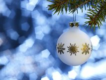 White Christmas bauble in blue back Stock Image