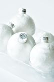 White Christmas baubles royalty free stock images