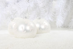 White christmas baubles in snow Stock Photos