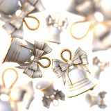 White Christmas Bells with a bow. Stock Photos