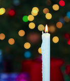 A White Christmas Candle with Blurred Lights Stock Images