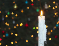 A White Christmas Candle with Blurred Lights Stock Image