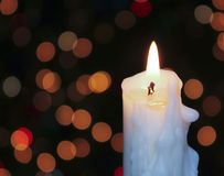 A White Christmas Candle with Blurred Lights Royalty Free Stock Images