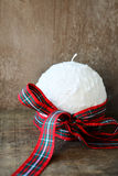 White Christmas candle with ribbon Royalty Free Stock Photos