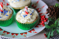 White Christmas Cupcakes. Christmas Cupcakes with white frosting and Candy Cane topper Royalty Free Stock Photo