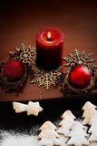 White Christmas - Decoration and cookies. Christmas decoration , red candle and cookies Royalty Free Stock Images