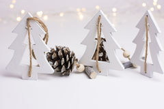 Free White Christmas Decoration In Scandinavian Style With Wood Fir Trees And Pine Cones, Bokeh Lights In The Background Royalty Free Stock Photos - 80670368