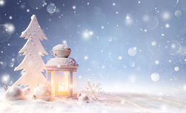 White Christmas Decoration With Lantern On Snowy Table royalty free stock photos