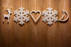 Christmas decorations against wooden background. Stock Photos