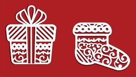 White Christmas decorations on red background: gift and sock. May use it for cutting Stock Images
