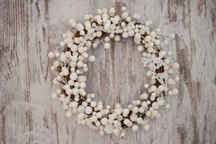 White christmas decorative wreath over wooden background Royalty Free Stock Photos