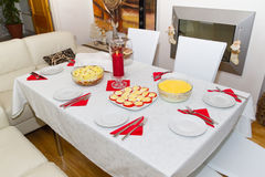 White Christmas dinner table. With salads and plates Royalty Free Stock Images
