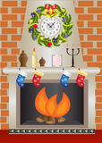 White Christmas fireplace. Fireplace with a fire burning against a brick wall Royalty Free Stock Image