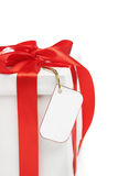 White Christmas gift with blank tag Royalty Free Stock Photo