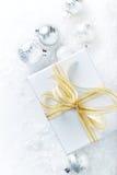 White Christmas gift with golden ribbon Stock Photo