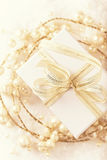 White Christmas gift with a golden ribbon Stock Photography