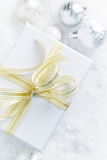 White Christmas gift with a golden ribbon Royalty Free Stock Image