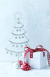 White Christmas gift with red ribbon Royalty Free Stock Photos