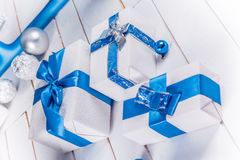 White Christmas gifts with blue ribbons Royalty Free Stock Image