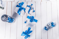 White Christmas gifts with blue ribbons Royalty Free Stock Photo
