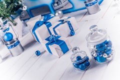 White Christmas gifts with blue ribbons Royalty Free Stock Photography