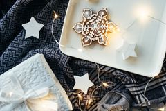 White Christmas gifts and decorations, presents and sweet ginger. Breads, holiday lights on traditional folk cloth background closeup royalty free stock photography