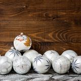 White christmas glass balls with wooden background Stock Photography