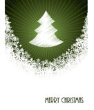 White christmas greeting with bursting christmastree from green Stock Image