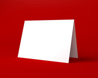 White Christmas Greeting Card on the Red Background Royalty Free Stock Image
