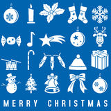 White Christmas Icons. And symbols set, isolated on blue background. Useful also as greetings card. Eps file available Royalty Free Stock Photo