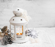 White Christmas Lantern with Ornaments on Painted Wood Royalty Free Stock Image