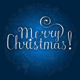 White christmas lettering on blue background with doodle hand drawn icons Stock Photography