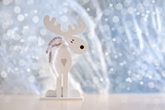 White Christmas moose with a heart Royalty Free Stock Photo