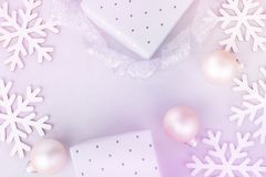 White Christmas New Year Banner Poster Background. Snow Flakes Baubles Gift Boxes. Scandinavian style pastel colors. Greeting Card. Copy Space royalty free stock photo