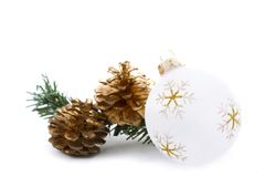 White christmas ornament with golden pine cones. On white Royalty Free Stock Photo