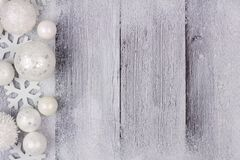 White Christmas ornament side border with snow on white wood Stock Images
