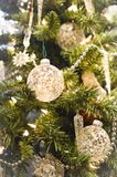 White Christmas Ornaments on Evergreen Tree stock photography