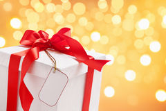White Christmas present with blank tag Royalty Free Stock Photography
