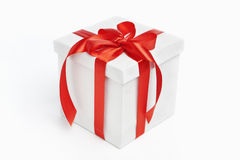 White Christmas present with red ribbon Royalty Free Stock Images