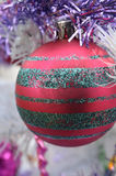 White Christmas red ball ornament with sliver glitter stipes Stock Image