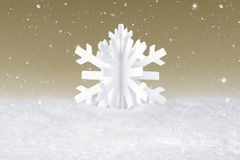 White Christmas snow flake decoration. On fake white snow Royalty Free Stock Image