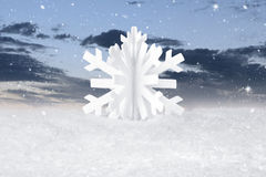 White Christmas snow flake decoration. On fake white snow Royalty Free Stock Photography