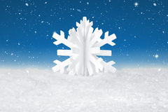 White Christmas snow flake decoration. On fake white snow Royalty Free Stock Images