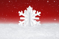 White Christmas snow flake decoration. On fake white snow Royalty Free Stock Photos