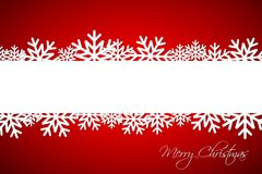 White Christmas snowflake on red background with blank space Stock Photography