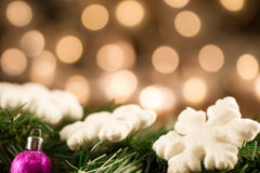 White Christmas snowflakes background defocused yellow lights. Stock Images