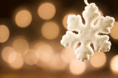 White Christmas snowflakes background defocused yellow lights. Royalty Free Stock Photography